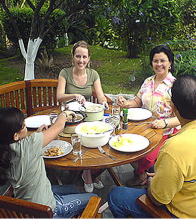 Immersion Spanish student having lunch with host family
