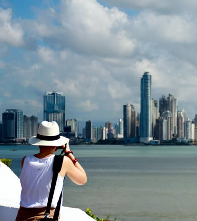Visitor in Panama City taking a photo of the skyline